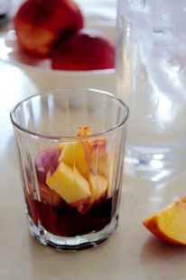 Fresh peaches served in red wine pairs beautifully with this recipe as a dessert.