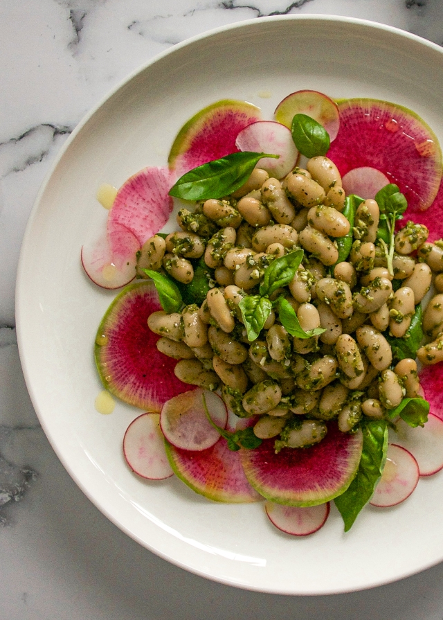 pesto beans on marble background